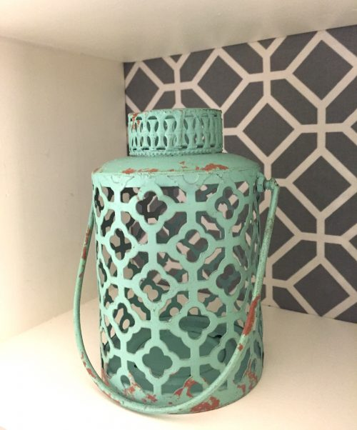Add a twist to any shelving unit by applying fabric to the back. Cute idea! #shelving