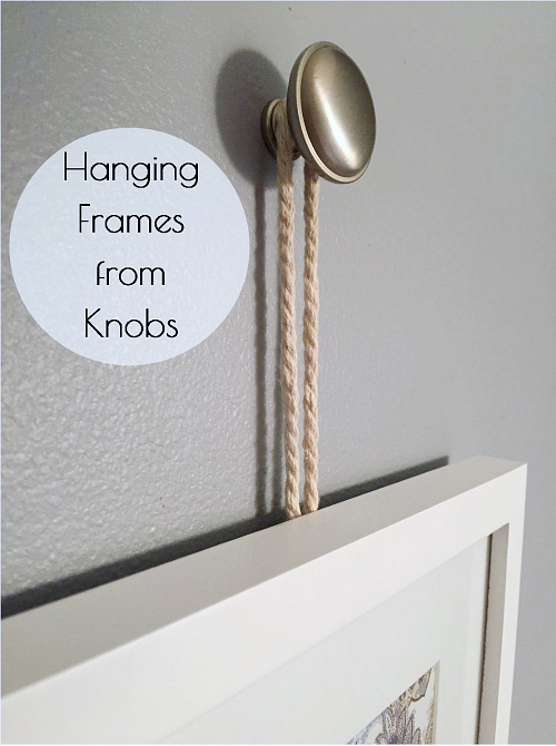 Such a cute idea to hang framed art or pictures from knobs.