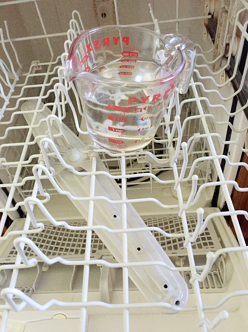 Cup of Vinegar to Clean Dishwasher