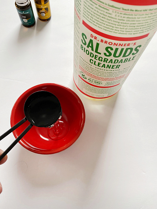 Adding Sal Suds to small bowl in order to make DIY Floor Cleaner