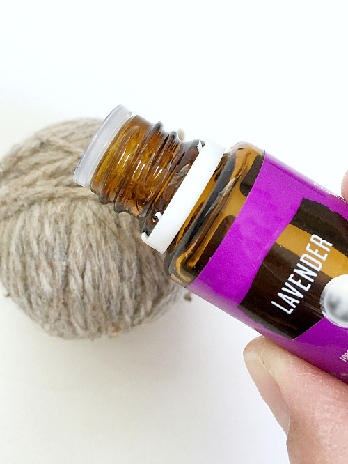 Adding essential oil to a dryer ball in order to scent drying laundry