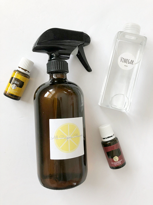 Ingredients needed to make a DIY All Purpose Spray: Vinegar and essential oils