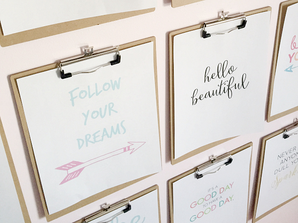 Creating a clipboard gallery wall with clipboards from the dollar store.