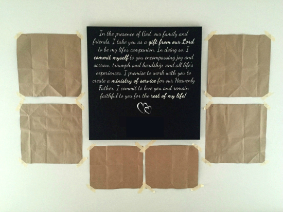 """Wall placement for gallery wall using paper bags and a center """"anchor"""" piece"""
