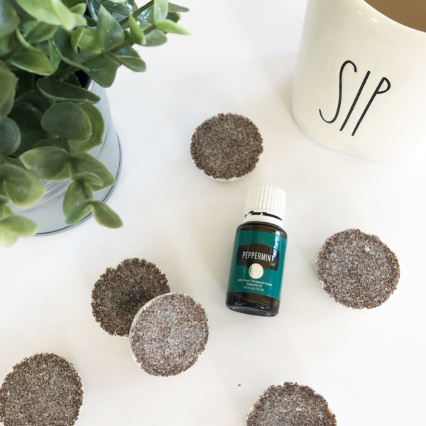 DIY Peppermint Mocha Wax Melts displayed with a cup of coffee and faux plant