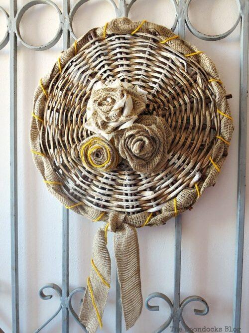 The bottom of a basket becomes free wall decor via The Boondocks Blog