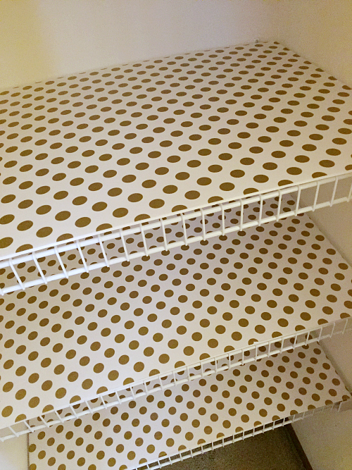 This is a perfect way to cover wire shelving using foam board and wrapping paper!