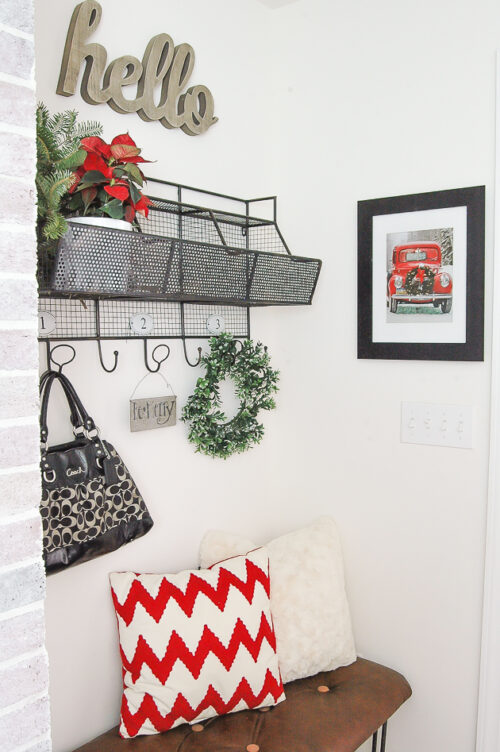 Framed gift bag becomes the perfect Christmas wall decor via Little House of Four