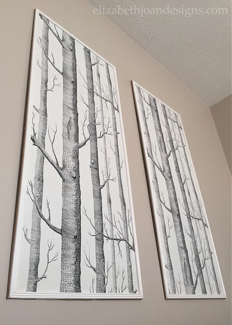 Large pieces of leftover wallpaper are framed for free wall decor via Elizabeth Joan Designs