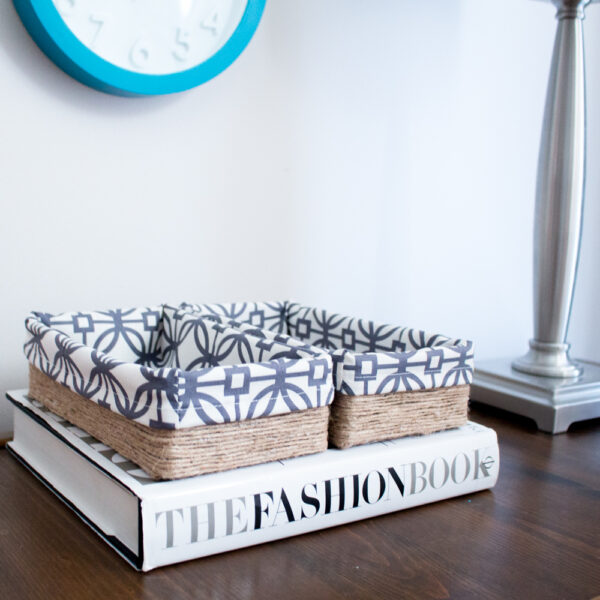 Use tissue boxes wrapped in twine and covered in fabric for a great looking storage option! Via Sustain My Craft Habit
