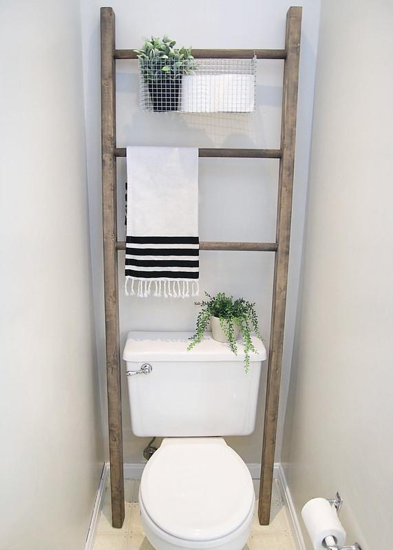 Farmhouse ladder above toilet in bathroom. Via Elizabeth Joan Designs