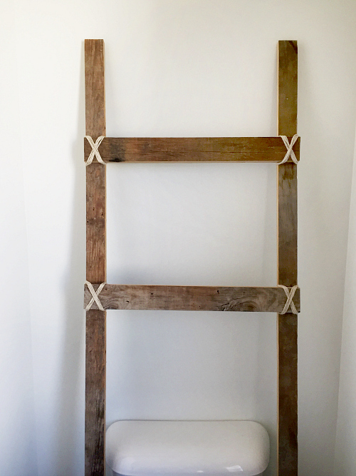 Lovin' this rustic ladder for the master bathroom!