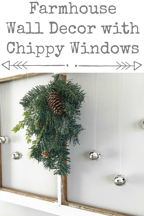 Farmhouse Wall Decor using an old window, decorated for Christmas.