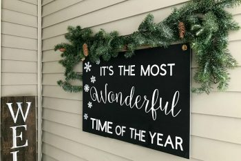 Such a cute Christmas porch. Love the budget-friendly signs that were added!