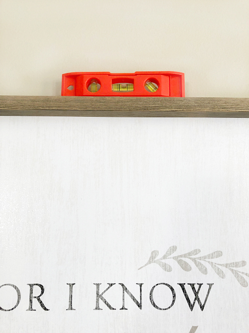 This trick is SO easy, and I now hang pictures straight and level every time. Can't believe toothpaste was the answer! #hangingpictures #hangframes #hangingframes #hangpicturesstraight
