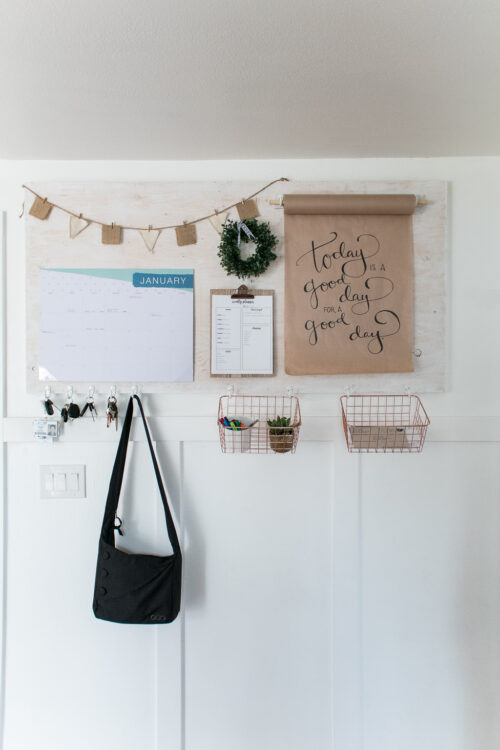 This command center from The Crafting Chicks is a great drop-zone with hooks for keys and purses along with small wire baskets for mails and other items.