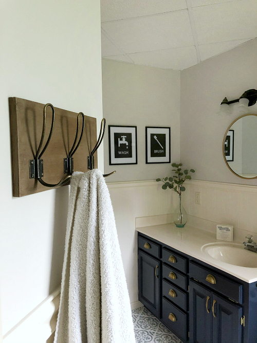 This bathroom makeover is seriously incredible! I cannot believe it was all done for less than $100! Stealing some ideas for my own bathroom inspiration. #bathroom #bathroomideas #bathroominspiration