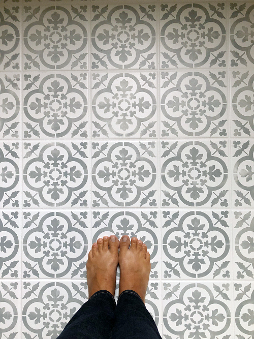 This tutorial for a DIY stenciled floor is amazing! So much great information. Step-by-step pictures, lessons learned, etc. #stenciledfloor #diystenciledfloor #floorstencil