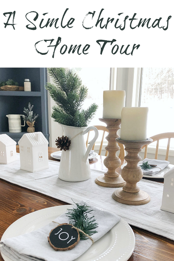 A simple Christmas home tour concentrating on the entry, dining room, and fireplace.
