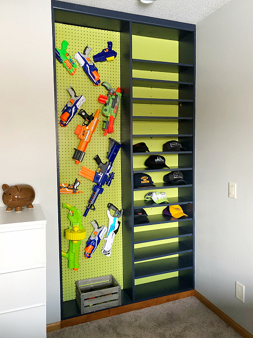 Boy Bedroom Nerf Gun Wall in a built-in shelving unit