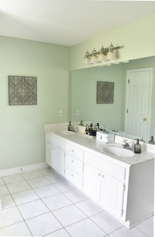 Favorite $100 Room Makeovers from the $100 Room Challenge. This bathroom from The Frugal Homemaker is absolutely incredible!