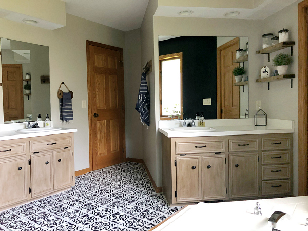 $100 Bathroom Makeover showing vanities that were made over with chalk paint and wax, along with a black and white stenciled floor