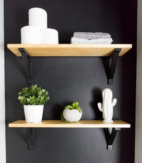 Open Shelving Against a Black Bathroom Wall- By Brittany Goldyn