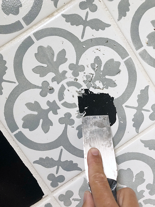 Fixing peeling paint on painted tile floor
