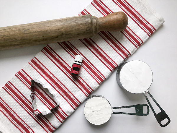 Items needed to make scented clay ornaments: baking soda, corn starch, essential oil