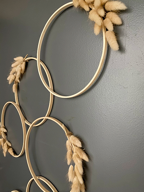 Finished Door Decor with embroidery hoops and wheat stems