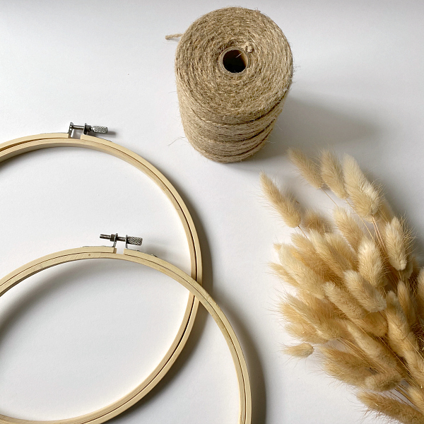 Supplies needed to create DIY Door Decor: Embroidery Hoops, Wheat Stems, Twine