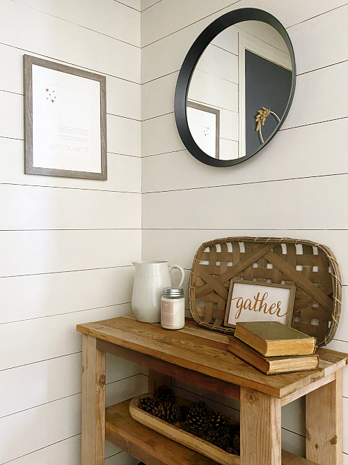 Wall decor for a farmhouse entry makeover including a round mirror and DIY print