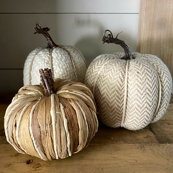 Neutral Textured Pumpkins used as fall decor for the entry makeover