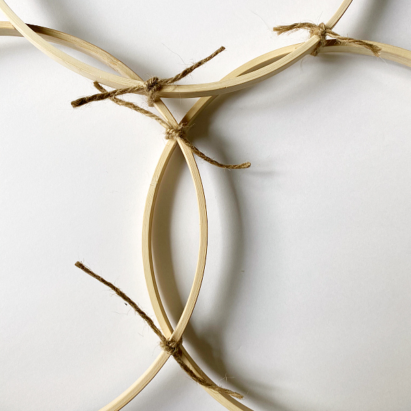Using Twine to secure embroidery hoops together for door decor