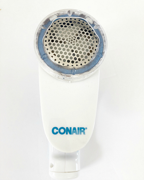 The easiest way to remove pilling from clothing and fabrics is this Conair Fabric Shaver.