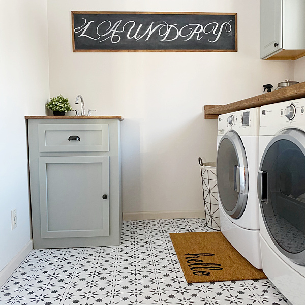 Framed Chalkboard Sign made from cardboard in this laundry room makeover