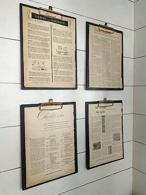 DIY Vintage Clipboards hanging on shiplap wall