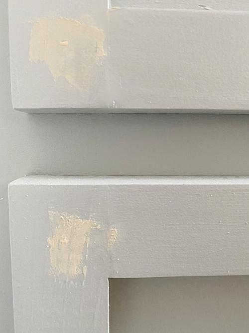 Wood filler in holes of faux vanity door and drawer
