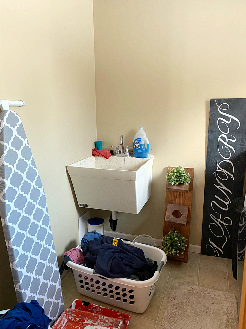 Laundry Room before makeover with view of the utility sink