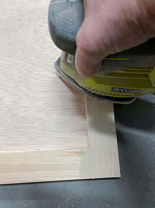 Sanding DIY Shaker Door prior to priming and painting.