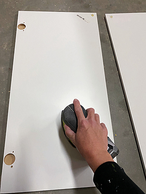 Use a mouse sander with a 120 grit sand paper to remove glossy sheen on laminate furniture prior to painting
