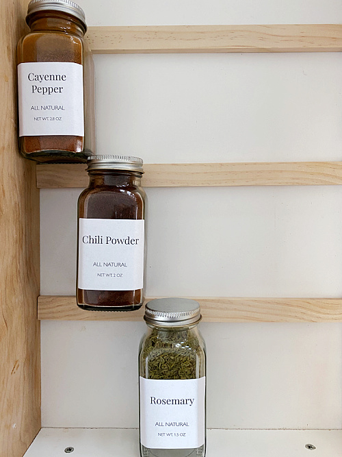 Propping spice jars up with wood slats