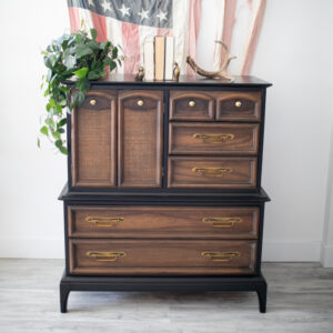 Black Dresser / Armoire with wood drawers and doors.
