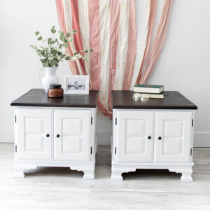 Two white nightstands with dark wood tops