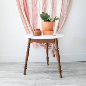 Small Round Table. Wooden legs with White StenciledTop