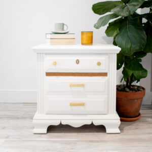 White nightstand / table with gold hardware and unique detailing