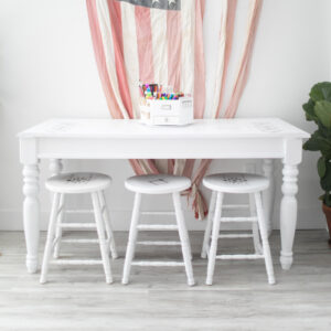 White Table with Three Stools. All include light gray stenciling