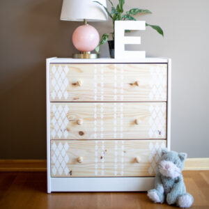 Light Wood Dresser with White Stenciling