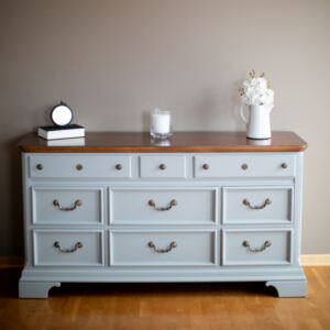 Nine drawer dresser with wood top, painted in the color Little Lamb by Fusion Mineral Paint. Antique Brass hardware.