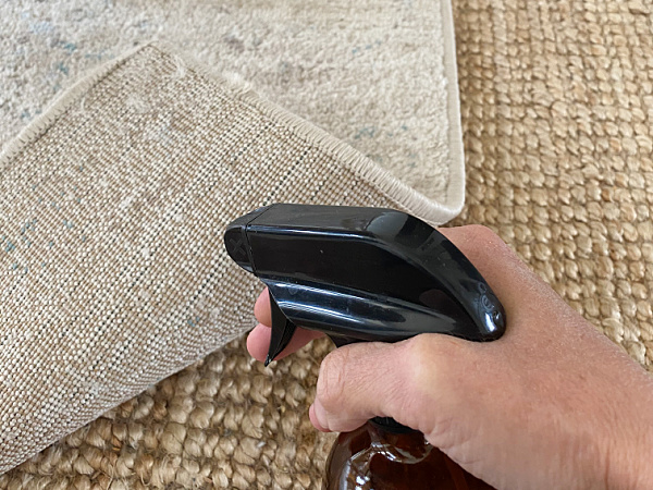 Spraying Carpet Corner with water to fix curling rug corner